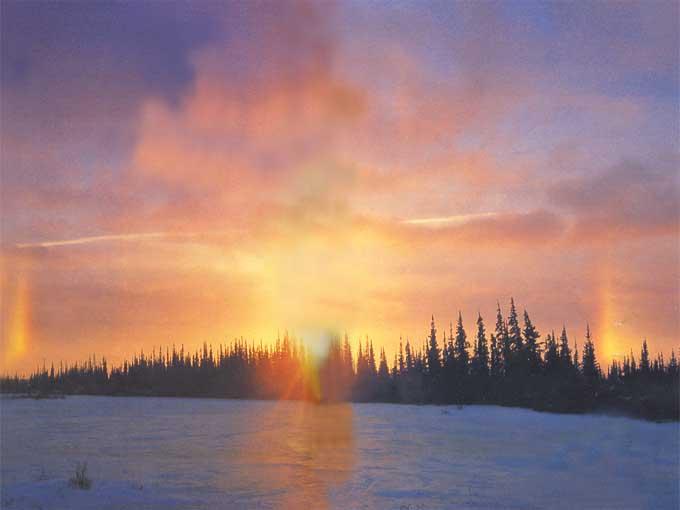 Un parhélie ? Un phénomène optique lié au halo solaire consistant en l'apparition de deux répliques de l'image du soleil… même si normalement ce phénomène n'est visible que dans les régions polaires.